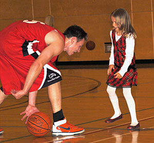 Brenden Graham plays with his niece, six-year-old Samantha, at half time. (Jessica Rolli photo)