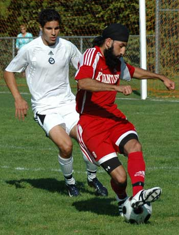 Kwantlen's Sukhjinder Chahal attempts to manouvre past a Capilano defender as the Eagles try to close a two-goal second-half deficit against the Blues. (Dave Pires photo)