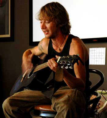 Daryl Markiewicz strums his guitar and sings an acoustic melody. (Cori Alfreds photo)