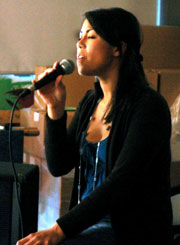 Erika Young sings to a Norah Jones track at Kwantlen's Open Mic Night at the Rainforest Café on the Surrey Campus. (Cori Alfreds photo)