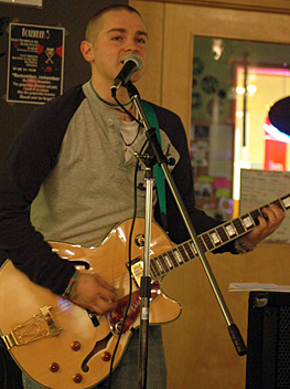 Johann Holesko sings at the second KSA-sponsored Open Mic Night at Surrey, held Nov. 5. (Cori Alfreds photo)