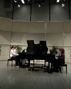 Performing the fifth and final movement of the piece are piano students Ethan Liang and Stuart Martin on the left and Queenie Cheng and May Miyaoka on the right.