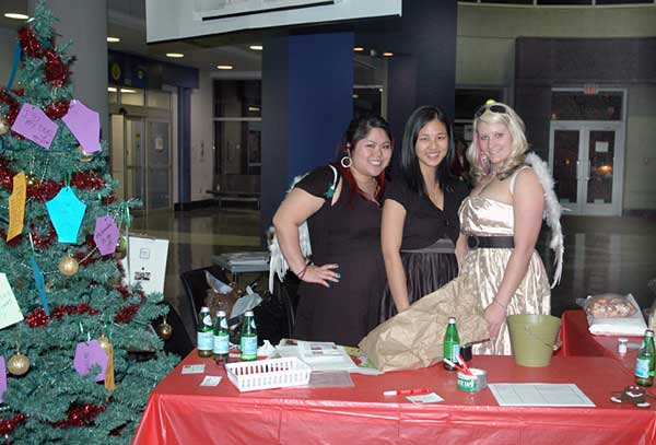(From left) Niki Chung, Carolyn Chow and Janis Brunk, all fourth year Fashion Design students, fundraise for the Julie Hobart SOS scholarship, in the Richmond Kwantlen rotunda on Dec. 4. (Keira Simmons photo)