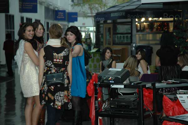 Fashion students mingle amid the display of their work and their portfolios. (Alexander Nkrumah photo)