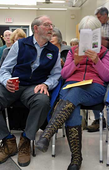 Tom McMath, left, looks as wife, Sharon, points out something in the Green Idea's Network brochure. (Sandy Buemann photo)