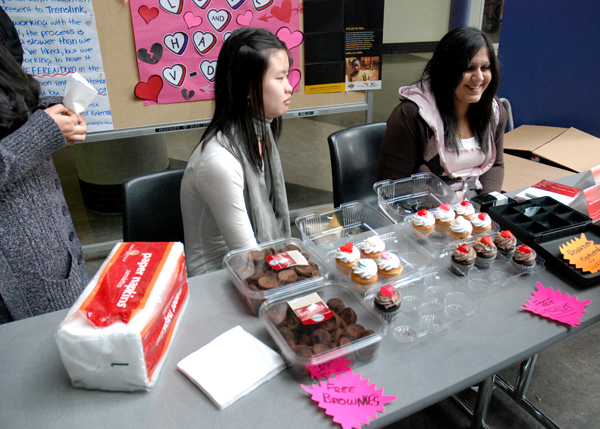 KSA Richmond campus director Reena Bali and Nicole Joe hand out free brownies and cupcakes to students passing through the rotunda on Valentine's Day. (Joseph Gloria photo)