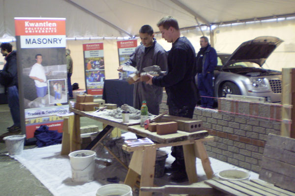 Two masonry students show off their craft in the Trades tent at Kwantlen';s Big Big Open House.