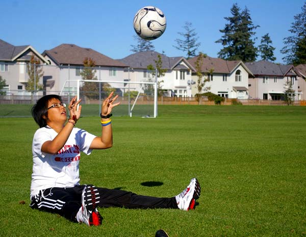 Injured goalkeeper Amelia Ng works on a catching drill at Goldstone Park in Surrey Thursday.