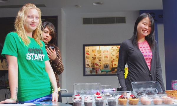 Jessica Ford (left) and Nicole Joe (right) sold cupcakes and brownies in support of breast cancer on Tuesday. (Kristi Jut photo)
