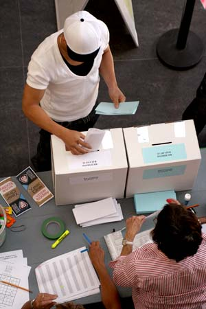 A Kwantlen student submits his referendum ballots. Volunteers were on hand to direct students towards the voting area.