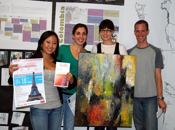 (From left to right) Third-year Interior Design students Whitney Chow, Anni Mergeran, Beatrice Muschol and Lucas Nightingale show off their advertising and an oil painting that will be featured as part of their silent auction at IDSwest.