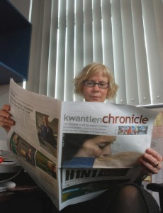 Beverley Sinclair, chair of Kwantlen's Journalism program, soaks in the latest issue of the Chronicle, which as of 2011 will be based in Surrey.