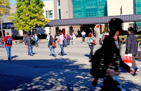 Students bustle between classes at Kwantlen's Surrey campus, which is busier this year because of a 10 per cent increase in student enrolment in the institution's university studies. (Sarah Jackson photo)