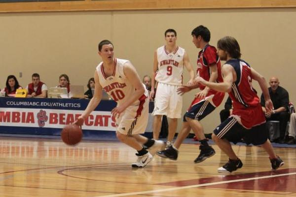 Doug Meyers keeps the ball away from Gage Ladouceur and Sheldon Leschert of the Bearcats. (Jacob Zinn photo)