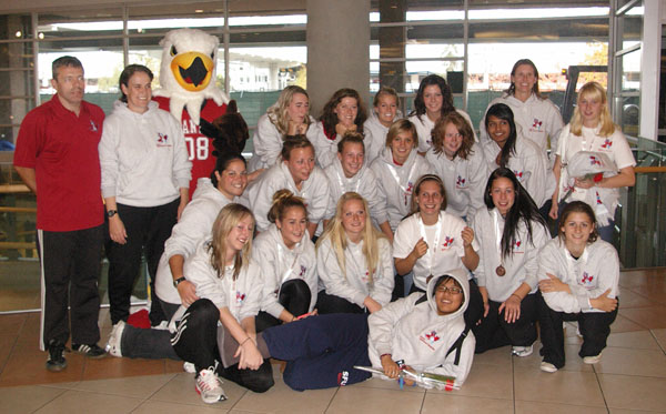 The Kwantlen women's soccer team at YVR with their bronze medals.