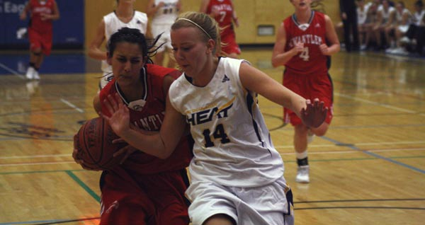 Taminder Dhaliwal (left) drives to the hoop against UBCO player Bailey Radley. (Mitch Thompson photo)