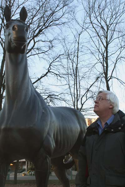 Bill Purver, archivist for the City of Richmond, examines a statue of Minoru commissioned by the city to honour the popular racehorse.