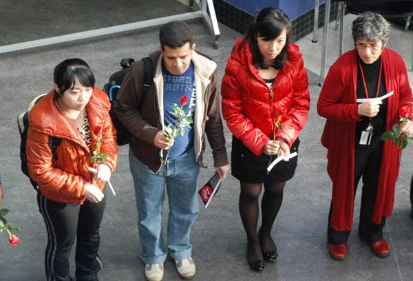 A small group of students stands quiety in memory of the 14 women killed. (Kim Ytsma photo)