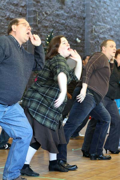 Jennifer Campbell joins her fellow actors in one of the plays many choreographed dane routines. (Katie Lawrence photo)