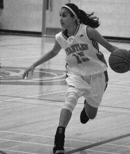 Taminder Dhaliwal drives up court against Vancouver Island University Friday. (Katie Lawrence photo)