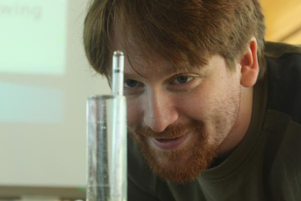 Nathan Griffiths shows how to use a hydrometer to measure alcohol at the Cloverdale campus on Jan. 19. (Jacob Zinn photo)