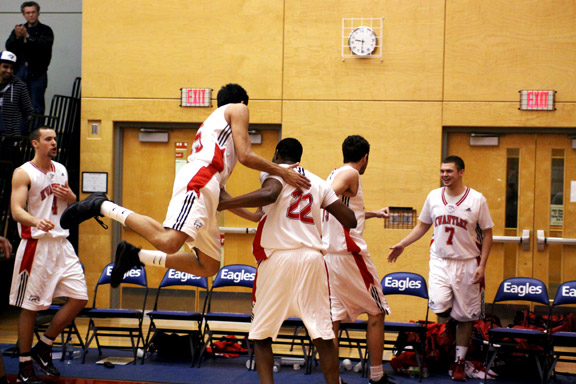 Varinder Singh gets airborne as he celebrates the Eagles win. (Justin Langille photo)
